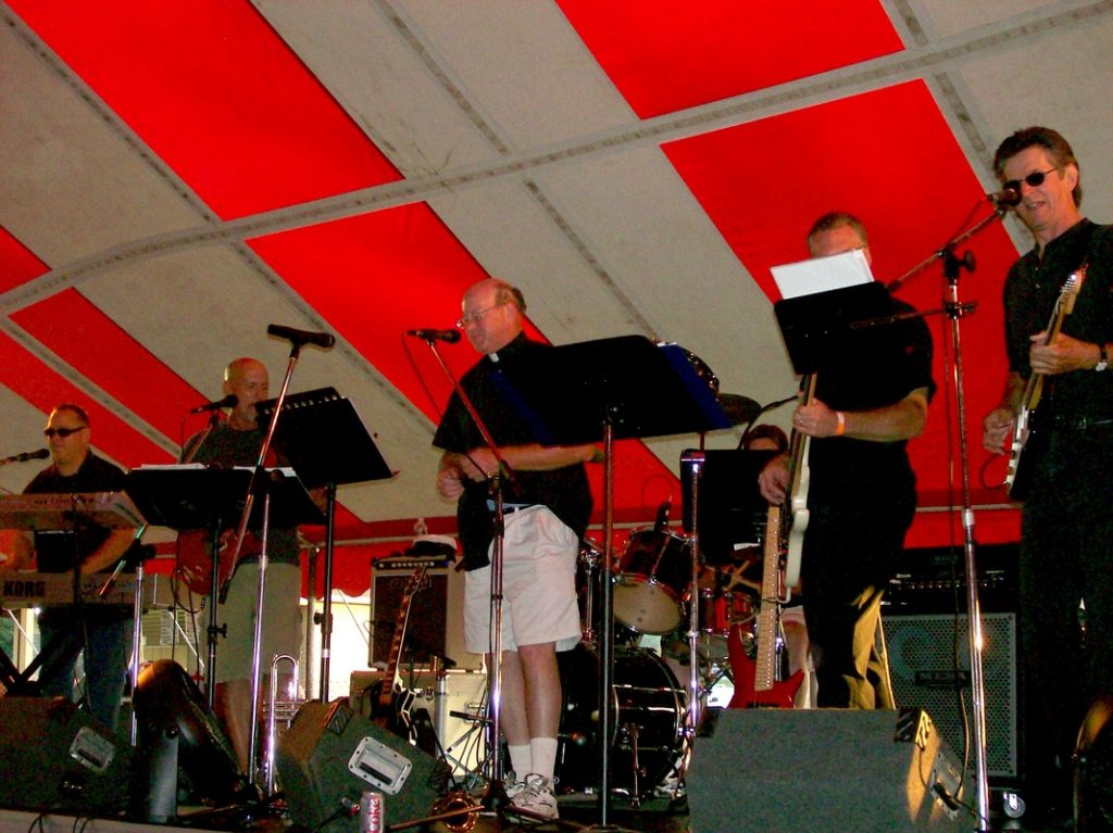 Band playing under big ten with Fr Brendan