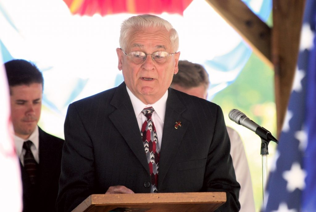 Deacon Romolo Leone speaks at the Dexter Memorial Day commemoration.