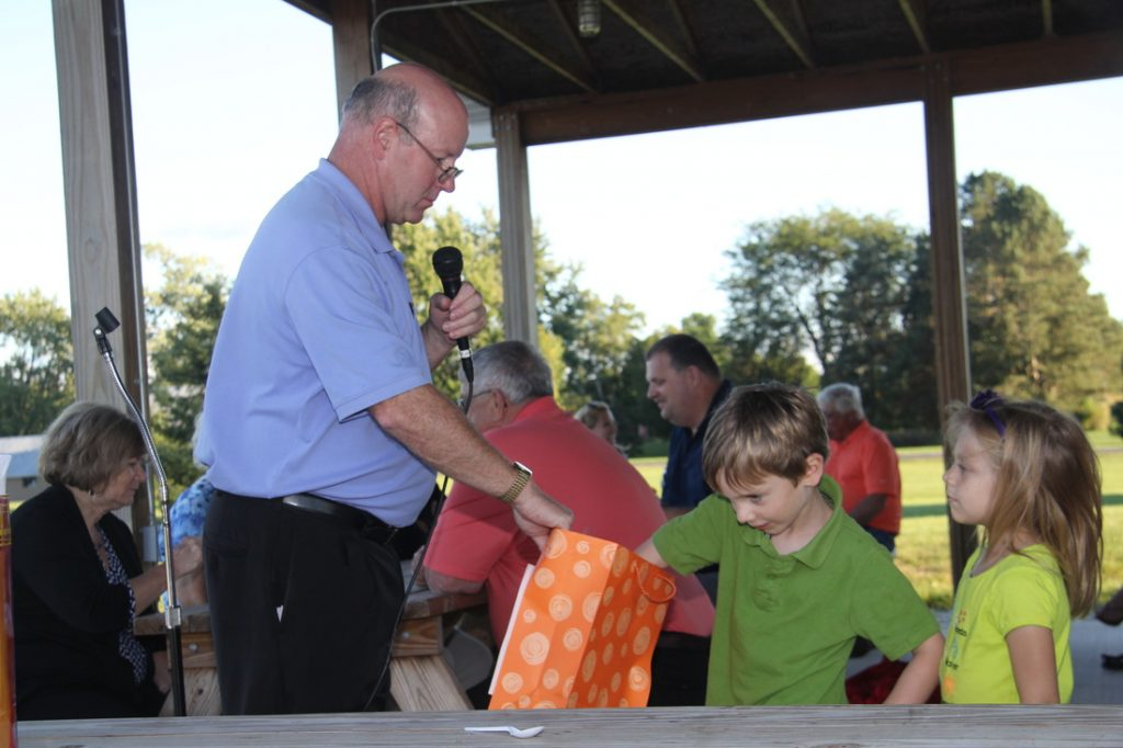 Kid Drawing for the door prize at the parish picnic.