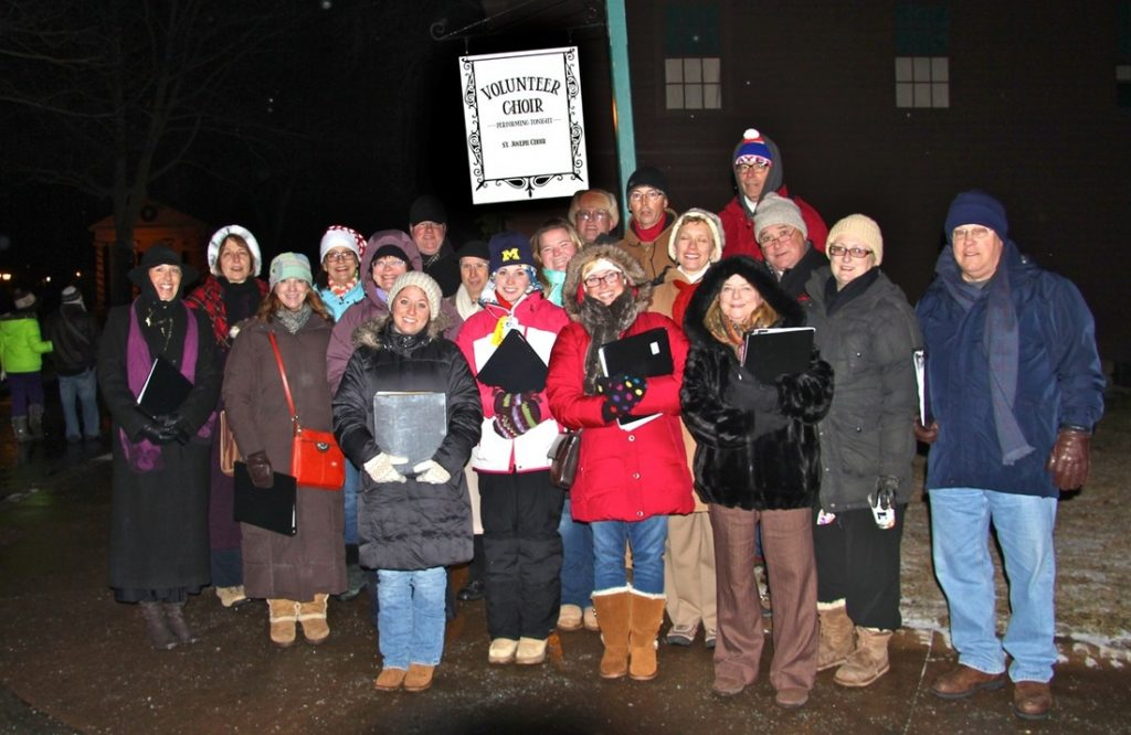 Kelly Rizzo-McLain with choir carolers at Greenfield Village.