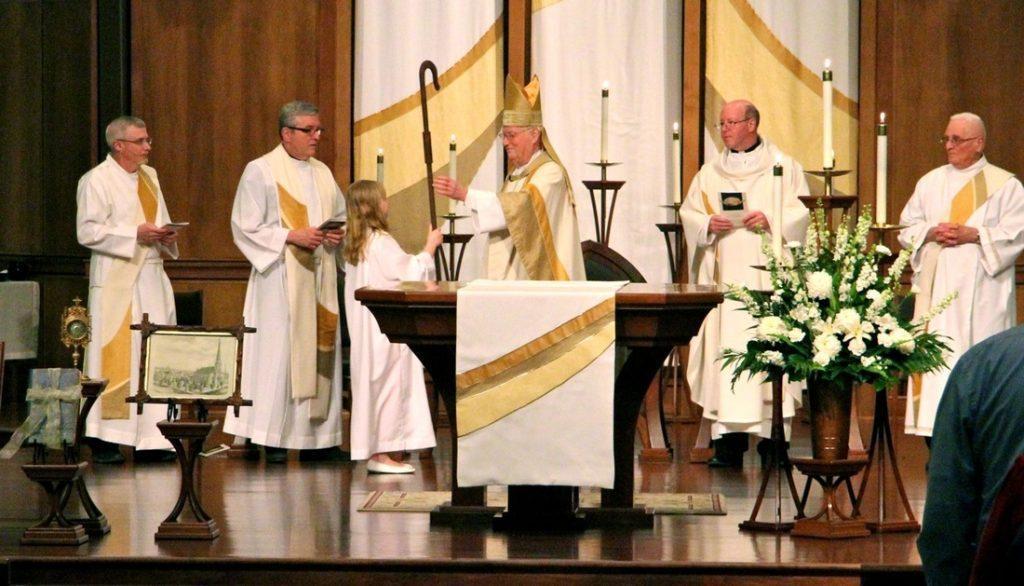 Bishop accepting his staff (crosier)