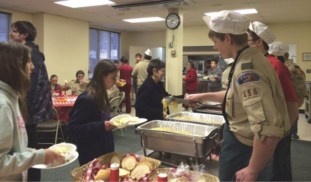 Boy Scouts and Confirmation candidates serve at the Spirit Weekend spaghetti dinner.