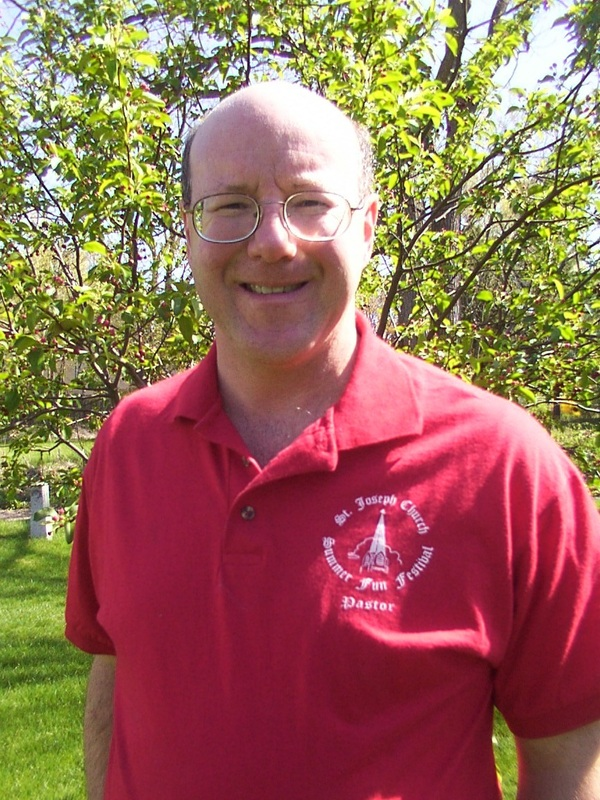 Fr. Brendan in Festival red.