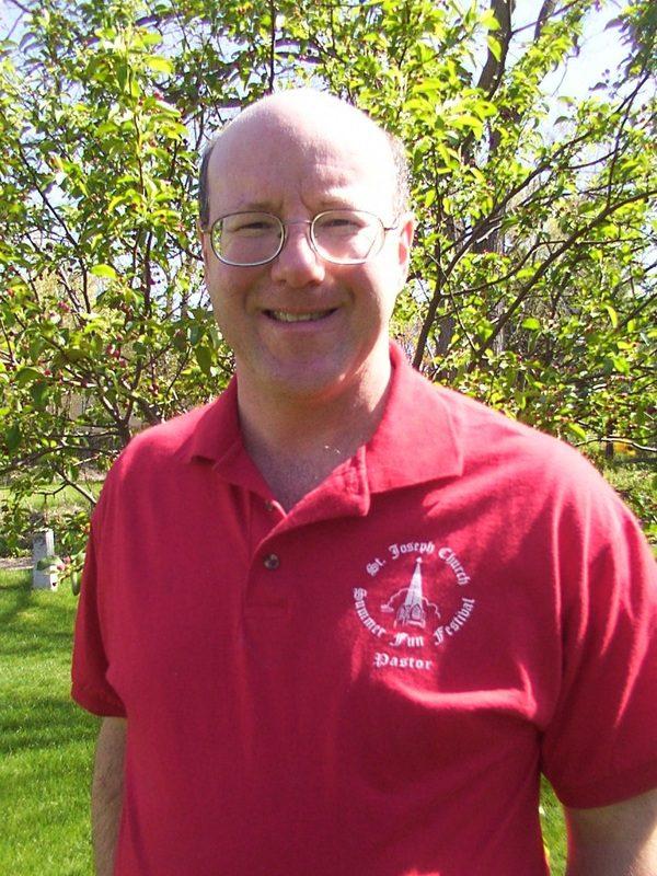 Fr. Brendan in Festival red.
