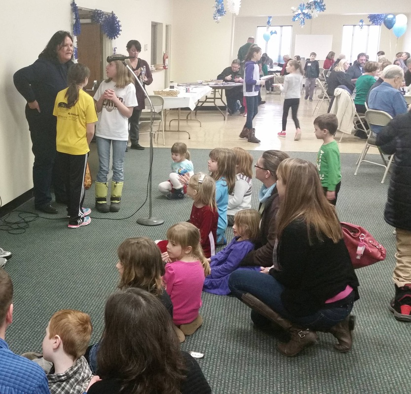 Emcee Eileen Slank answers kids' questions at the Winter Fest.