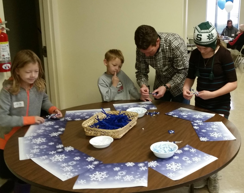 Dad helps with this project, winter family fun fest